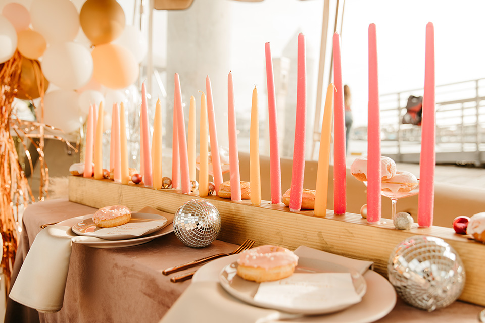 1970s golden hour boat elopement – candles and decor