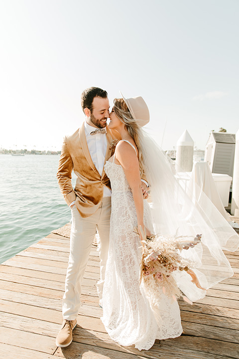 1970s golden hour boat elopement – embrace and kissing