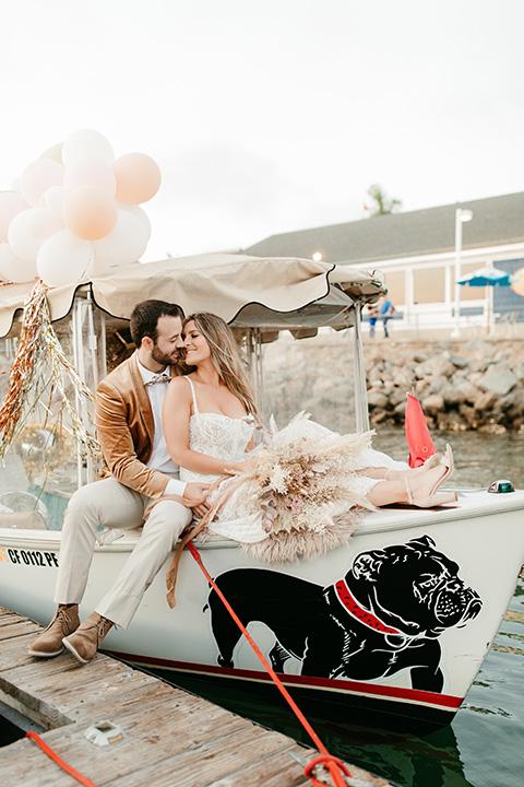 1970s golden hour boat elopement – walking on boardwalk at boat