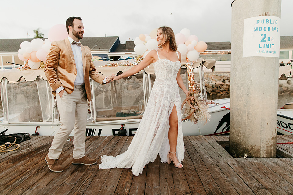 1970s golden hour boat elopement – walking to the boat