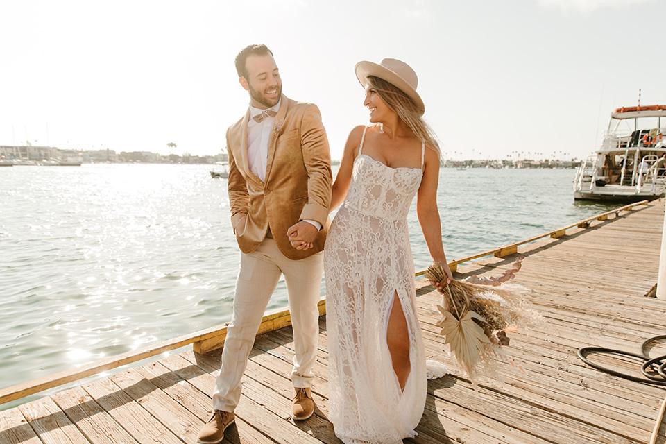 1970s golden hour boat elopement – walking on the board walk