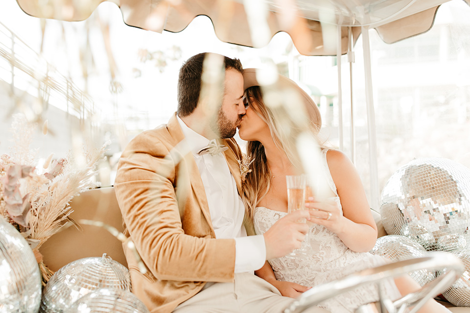 1970s golden hour boat elopement – kissing on the boat