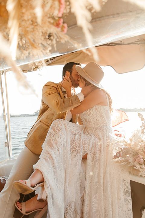 1970s golden hour boat elopement – in boat