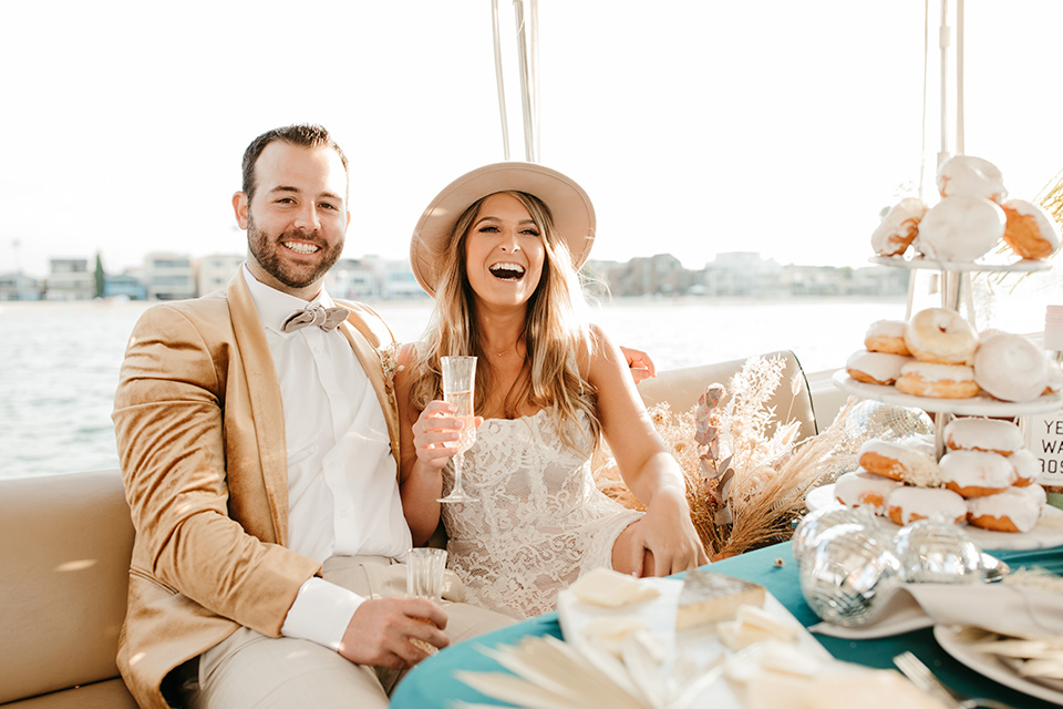 1970s golden hour boat elopement – couple on boat