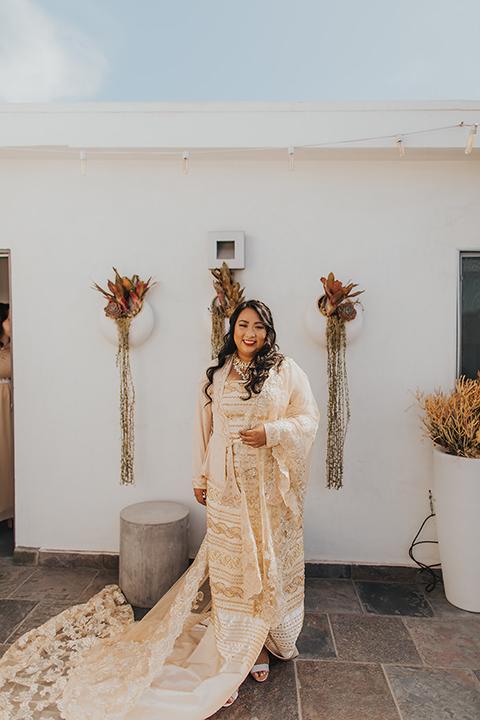 bride in a golden Burmese gown