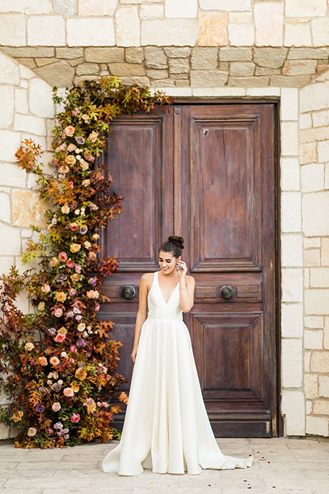 old world wedding at Allegretto Vineyard Resort – bride in a long gown with a cutout back design
