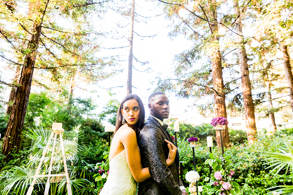 the bride was in a strapless formfitting gown with a crystal bodice and the groom in a black paisley tuxedo with a grey velvet bow tie