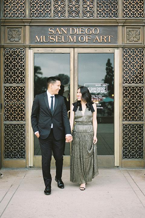 bride and groom eloping at balboa park – couple walking