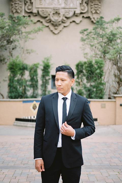 bride and groom eloping at balboa park – groom close