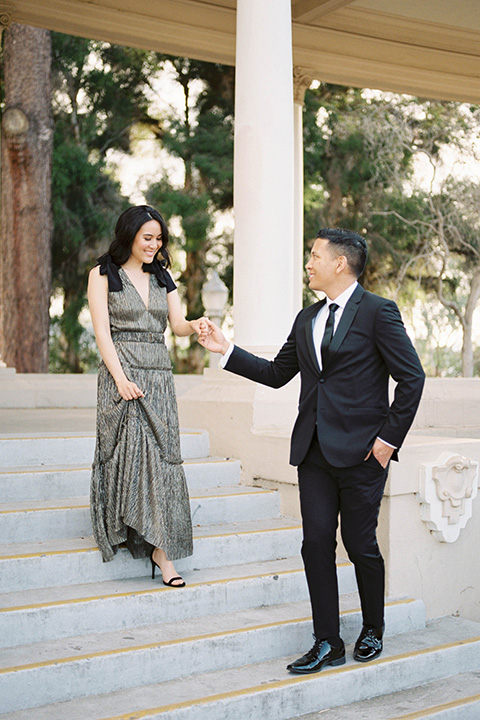 bride and groom eloping at balboa park – holding hands