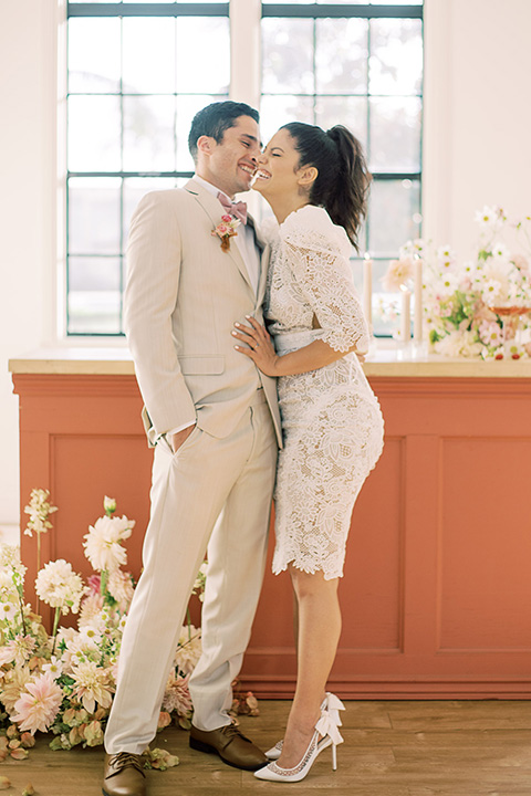 building 177 romantic coral wedding – couple at bar in short dress