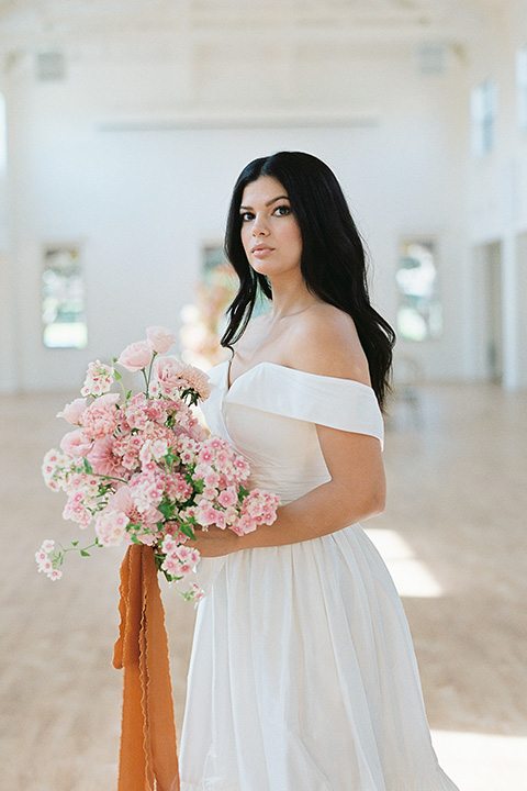 building 177 romantic coral wedding – gown in a long dress with an off the shoulder detail