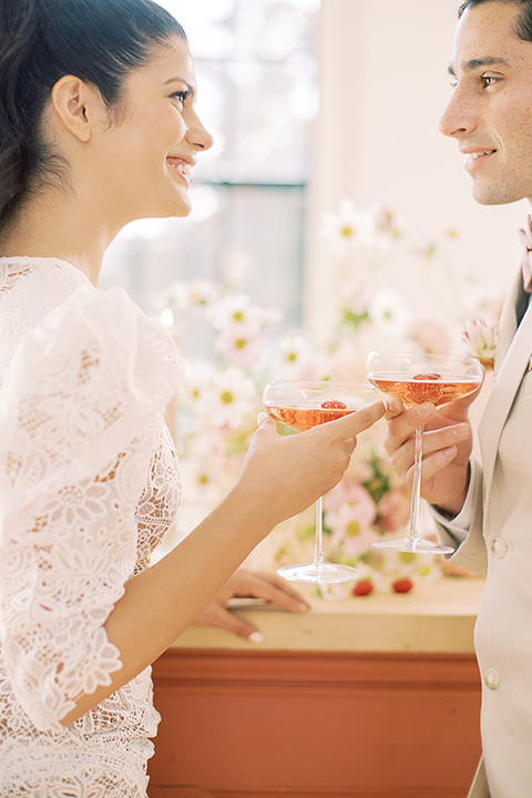 building 177 romantic coral wedding – couple with drinks