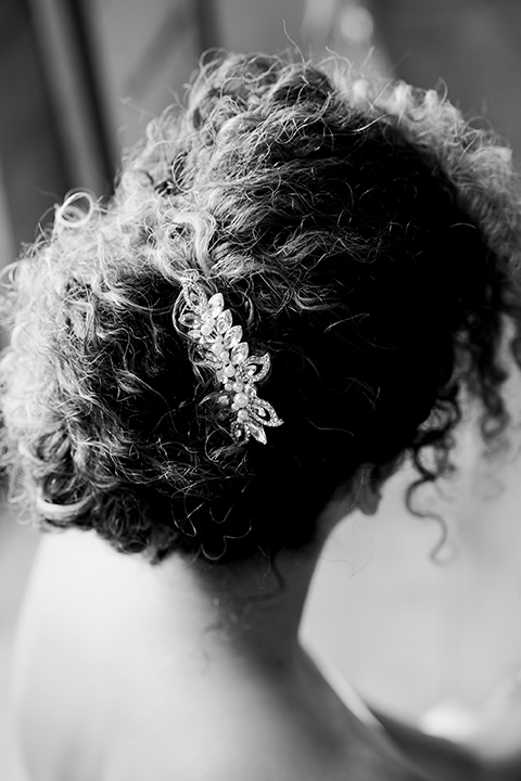 bride in a two-piece gown with her hair in a chic up-do