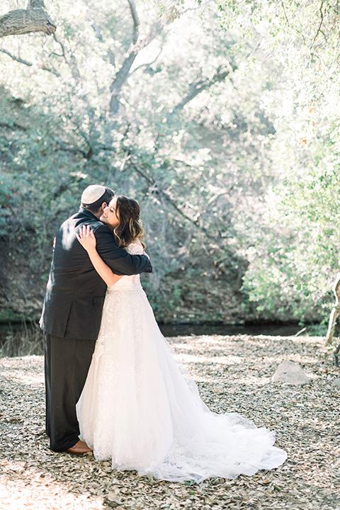 father of the bride in a black tuxedo