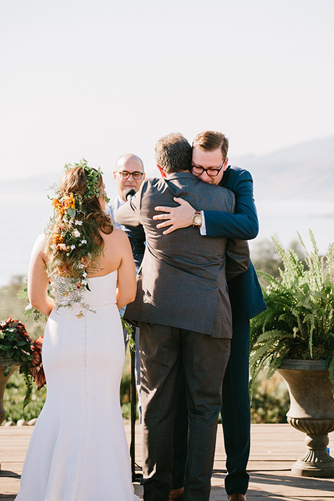 father of the bride in a charcoal grey suit