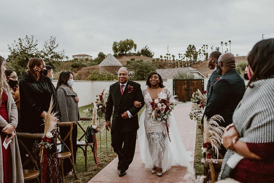 father of the bride in a black velvet tuxedo
