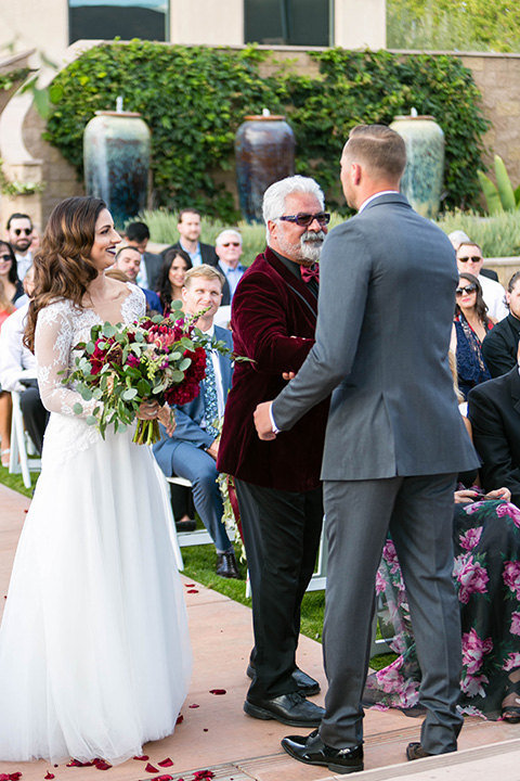 father of the bride in a light grey suit