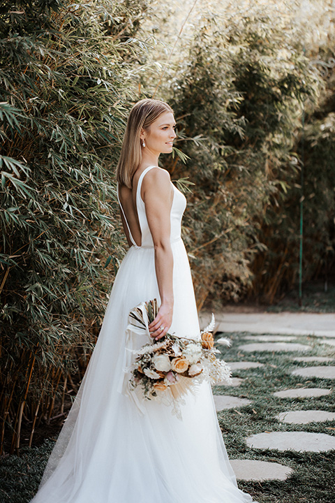 alleylujah neutral wedding – bride in a long tulle gown with a low cut back