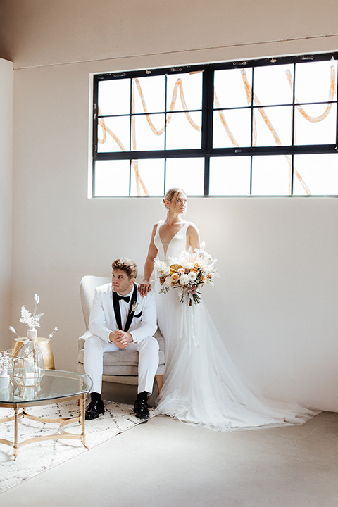 alleylujah neutral wedding – bride in a modern white gown and the groom in a white shawl lapel tuxedo