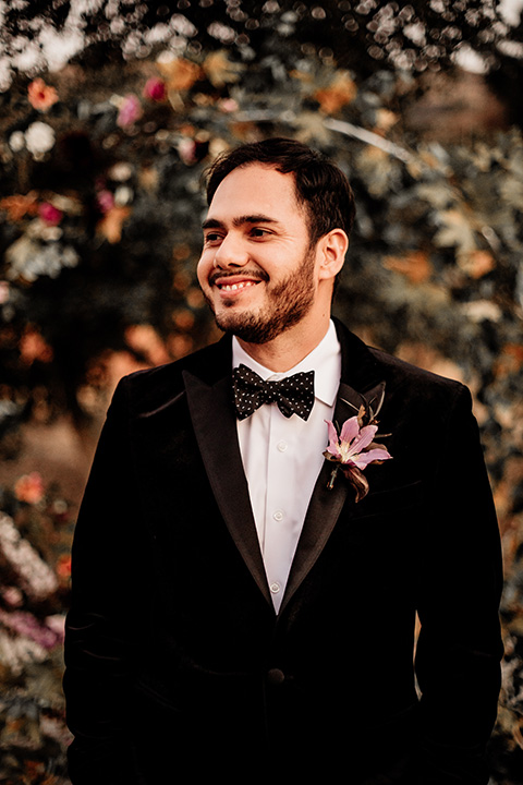 halloween inspired wedding with the groom in black velvet tuxedo