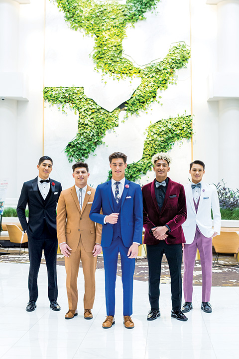 guys in all different colors of suits and tuxedos for homecoming