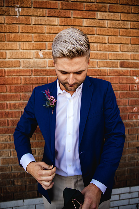grooms in the same cobalt blue suit with 2 different color ties