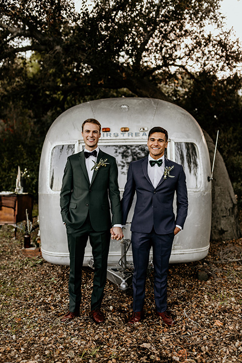 grooms in the same cobalt suit with 2 different color ties