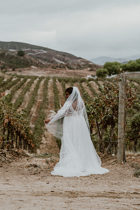 Letitia and Zach's romantic vineyard burgundy + rose wedding – bride in her lace gown with long sleeves