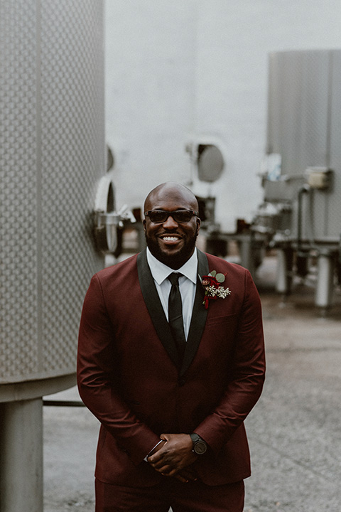 Letitia and Zach's romantic vineyard burgundy + rose wedding – bride in her lace gown with long sleeves and the groom in a burgundy shawl lapel tuxedo