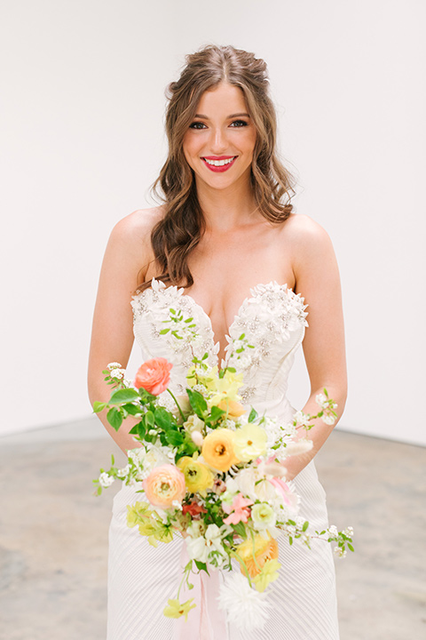 bride in a fashionable white jump suit with a strapless neckline and wide leg
