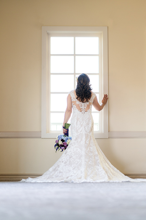 one bride in a white mermaid style gown with a beaded bodice and strapless neckline