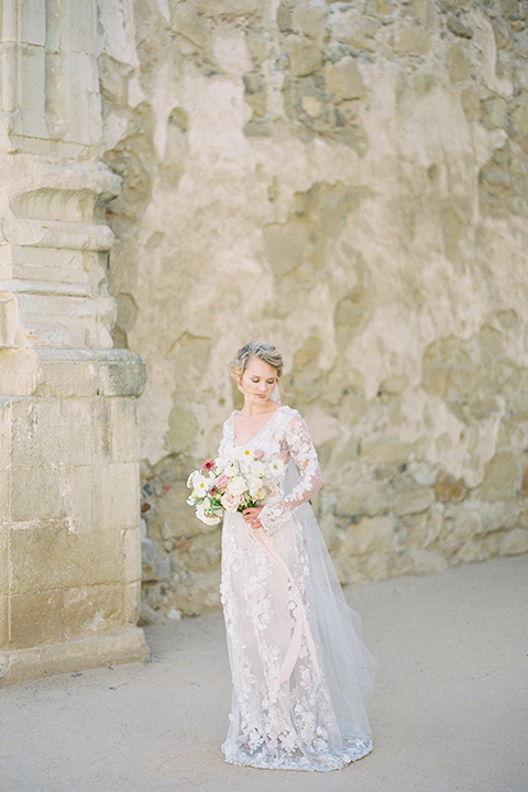 bride in a lace white gown with long illusion sleeves