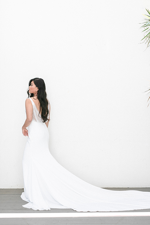 bride in a formfitting gown with a high neck and a long train