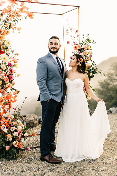 bride in a white strapless gown and the groom in a light blue coat and dark blue pants