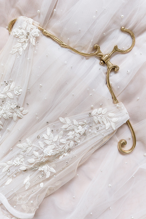 close up of a bridal gown with an illusion neckline