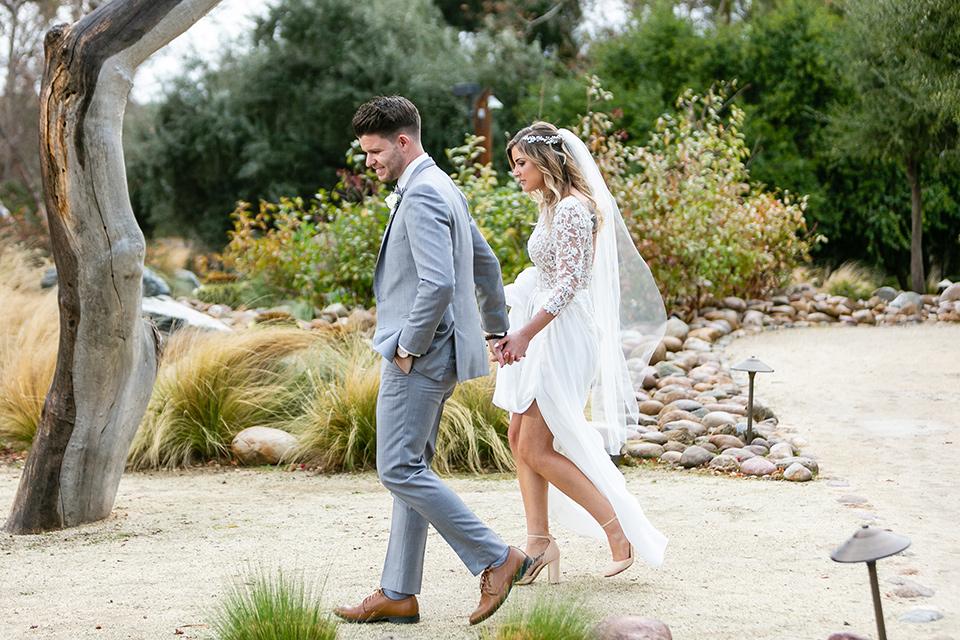 garden California floral wedding – couple walking