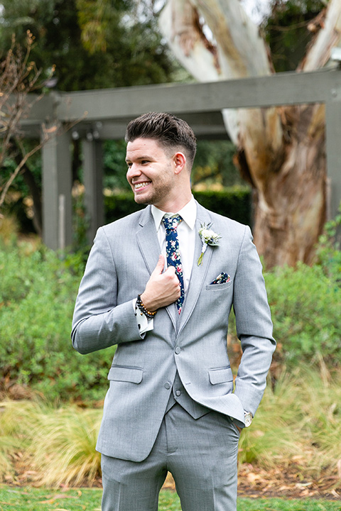 blue and red rustic garden wedding – groom
