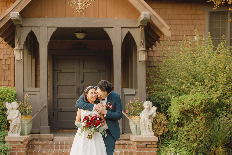 red and blue farmhouse wedding – couple embrace