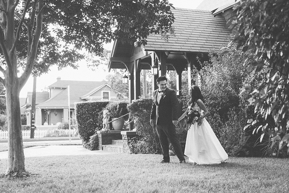red and blue farmhouse wedding – couple walking