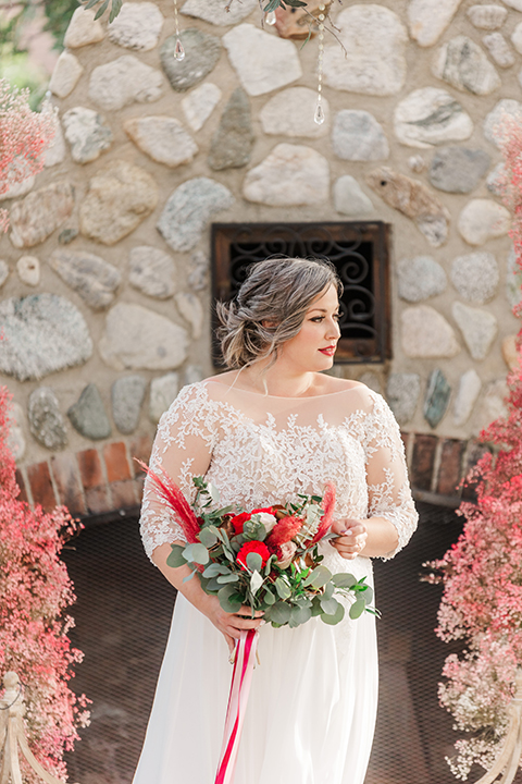 bride in a white and ivory gown with a natural waist and lace long sleeves