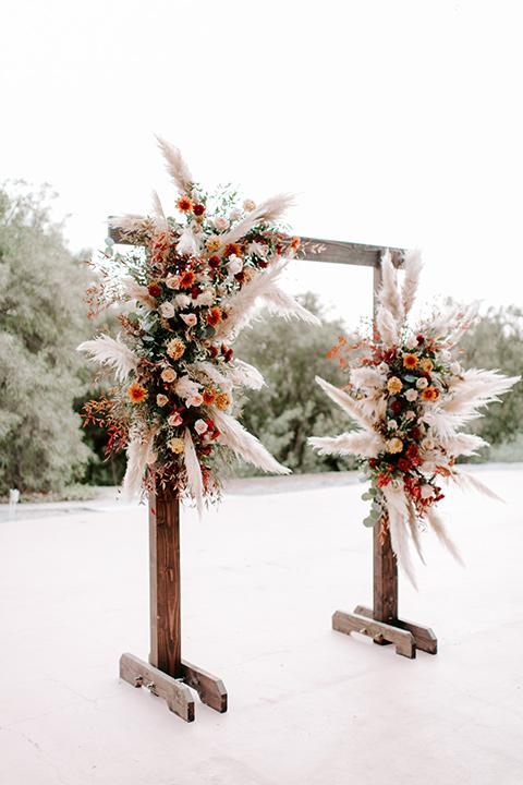 bohemian orange wedding – ceremony arch