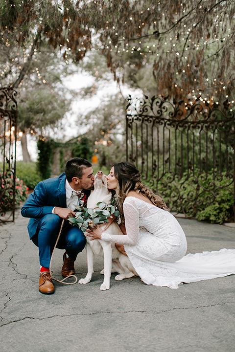 bohemian orange wedding – couple with dog