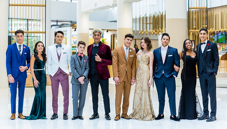 Teens dressed in suits and tuxedos for prom